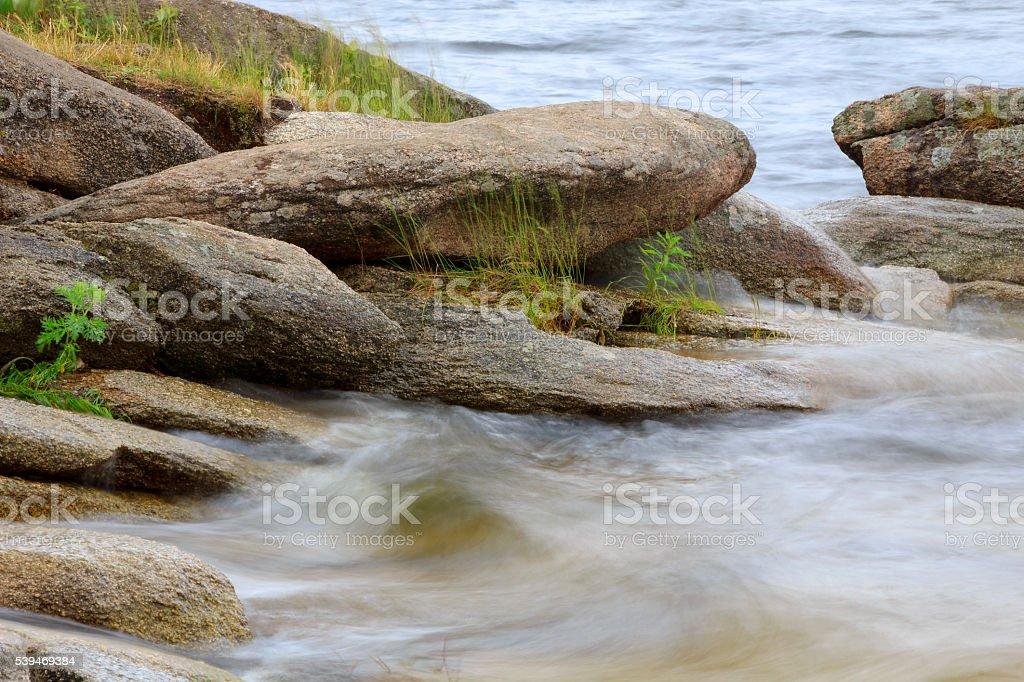 Shore large stones stock photo