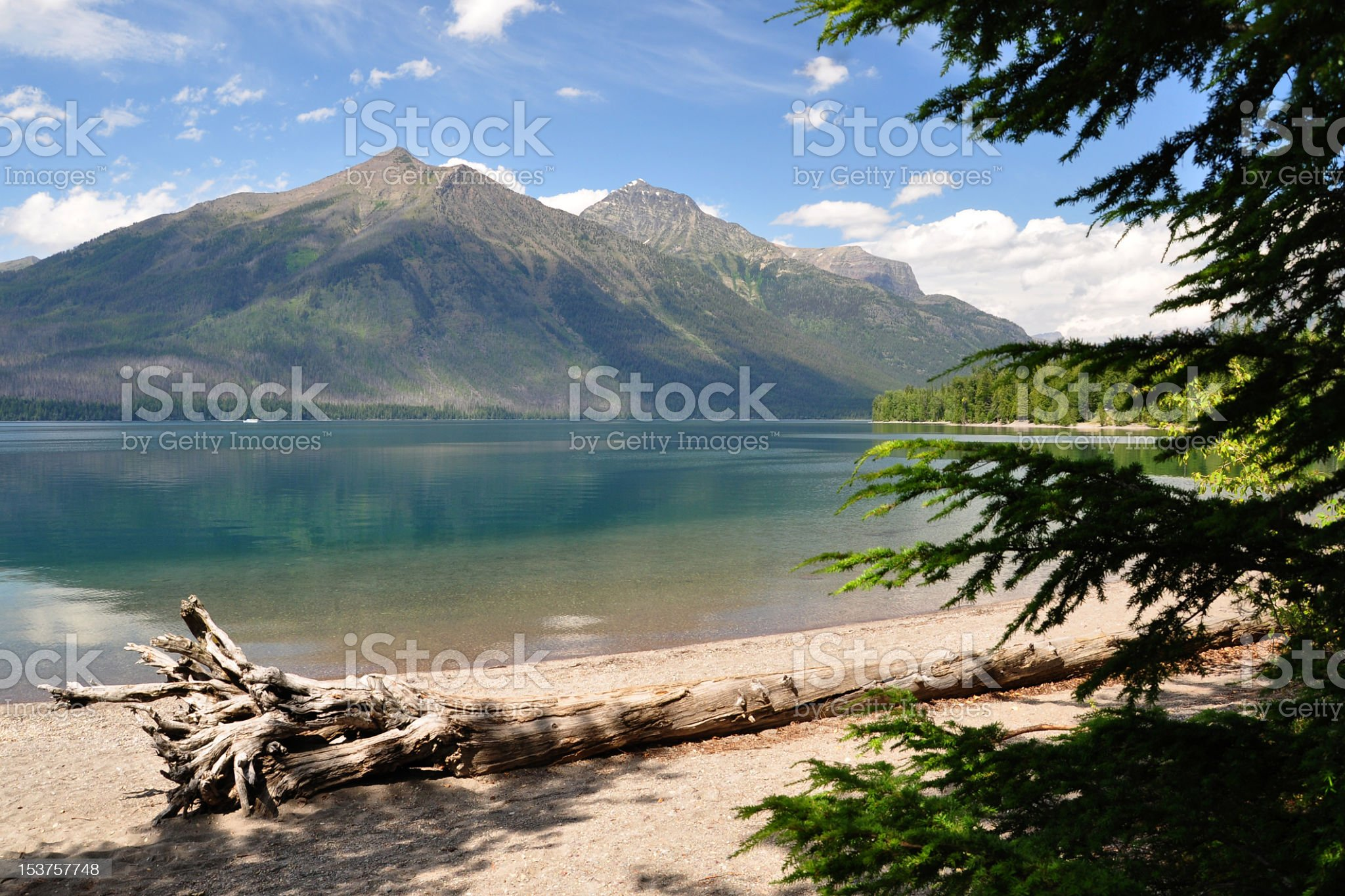 Shore of Lake McDonald, Montana with mountains in the background royalty-free stock photo