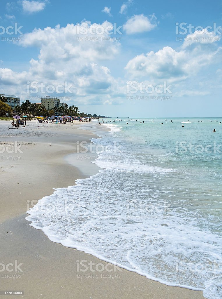 Shoreline Beach with Blue Sky and Clouds in Naples, Florida stock photo