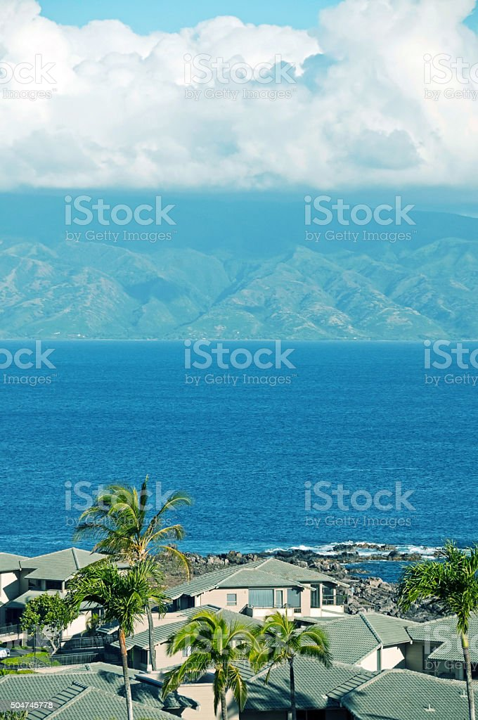 Shoreline houses on Maui looking across channel to Molokai stock photo