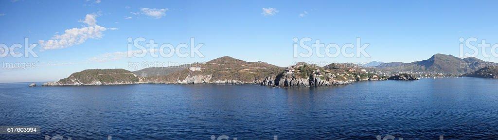 Shoreline of Harbor opening in Zihuatanejo, Mexico stock photo