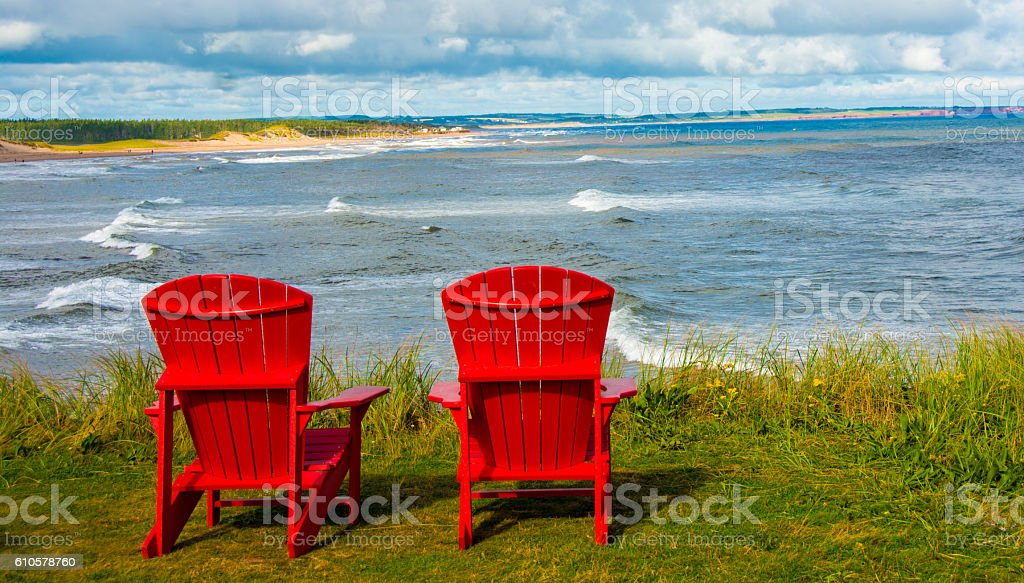 Shoreline plus red chairs  Prince Edward Island National Park stock photo