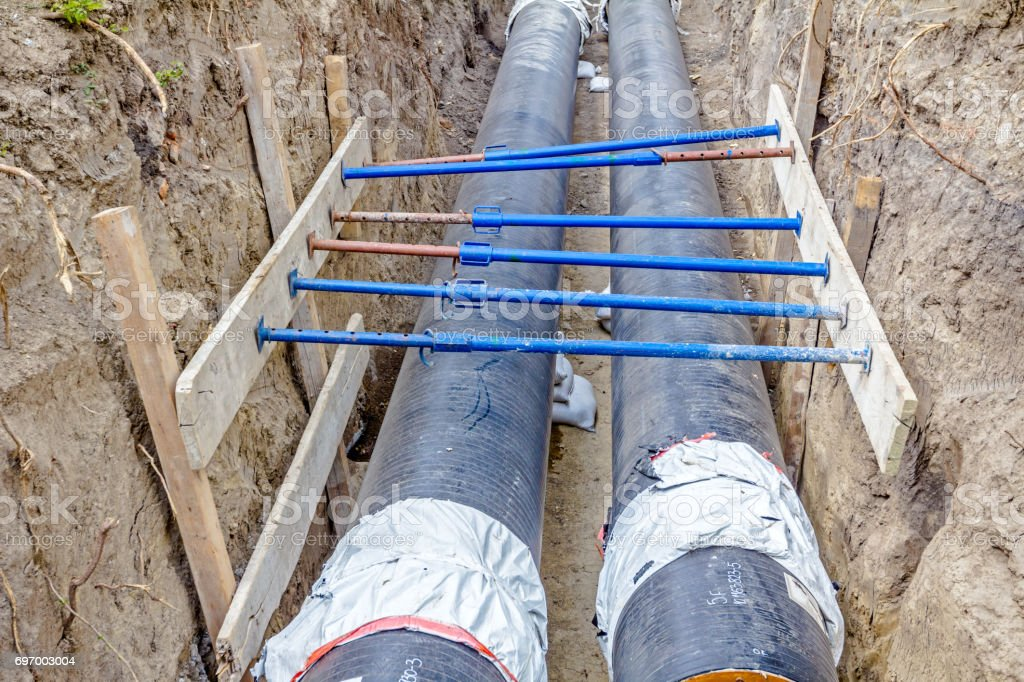 Shoring supports walls of a trench to protect workers stock photo