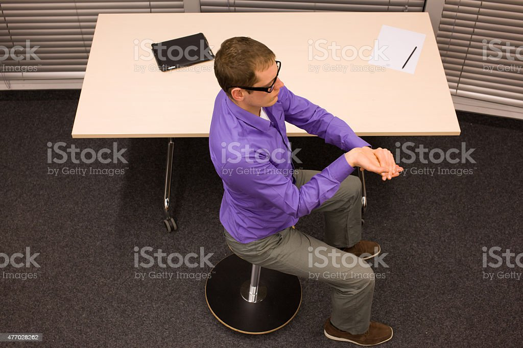 short break for exercises in office at workplace stock photo