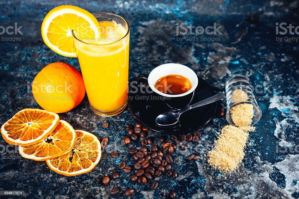 Short espresso coffee and fresh orange juice stock photo
