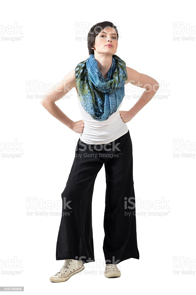 Short hair fashion model with colorful shawl and wide trousers stock photo
