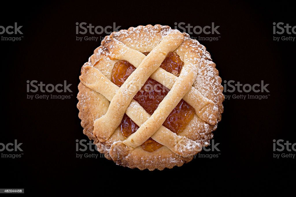 Short pastry tartlet with marmalade. stock photo
