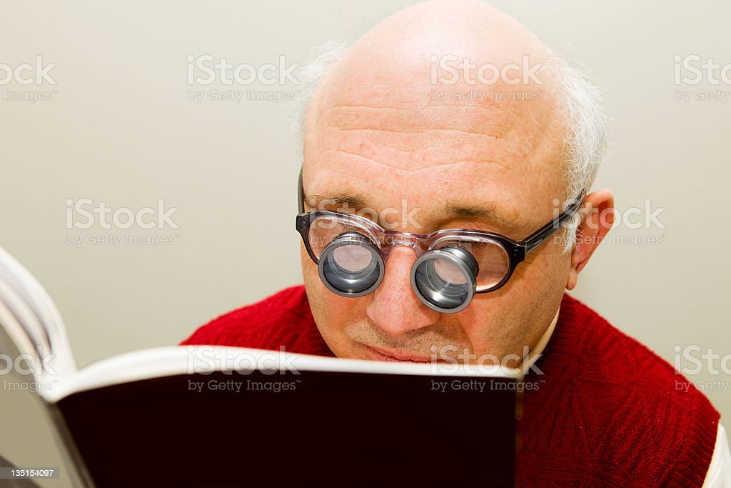 Short sighted midget with special glasses royalty-free stock photo