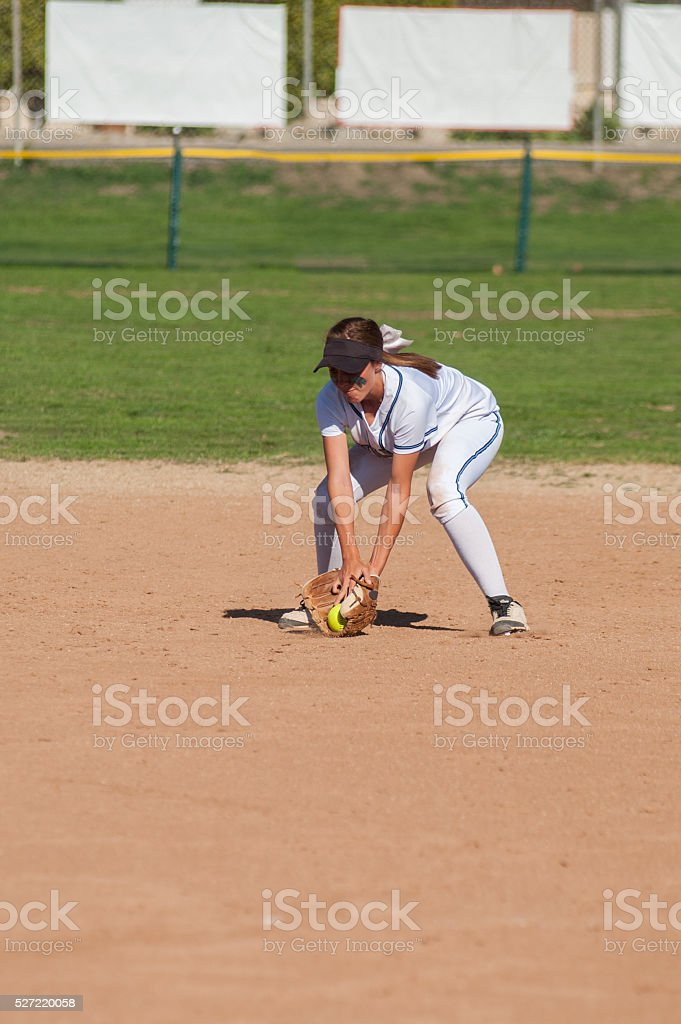 Short stop fielding the ground ball stock photo