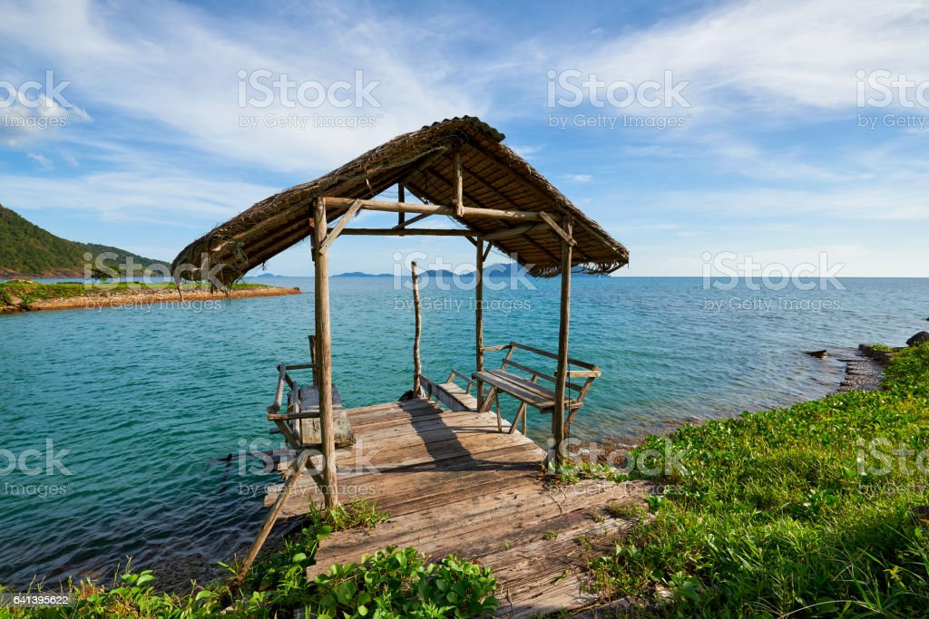 Short wooden jetty at the beach of the Koh Chang, Thailand stock photo