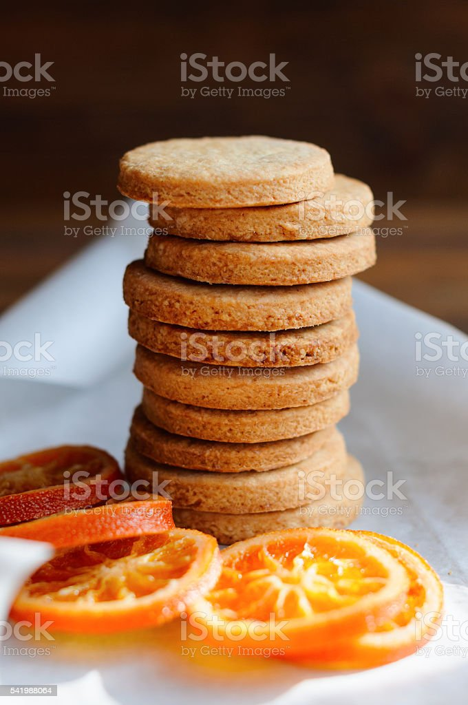 Shortbread cookies stacked on table stock photo