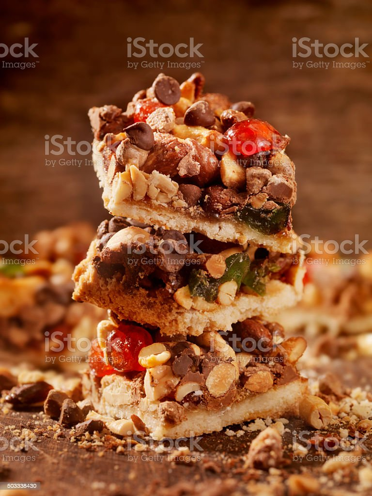 Shortbread Squares with Candied Nuts, Fruit and Chocolate stock photo