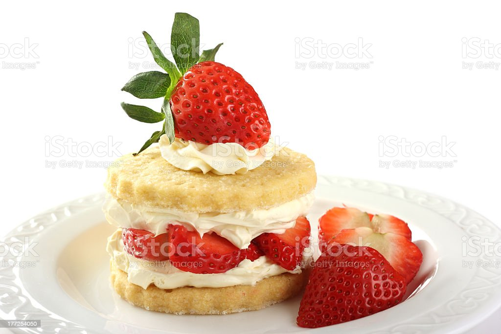 Shortcake stacked with strawberries and whipped cream stock photo
