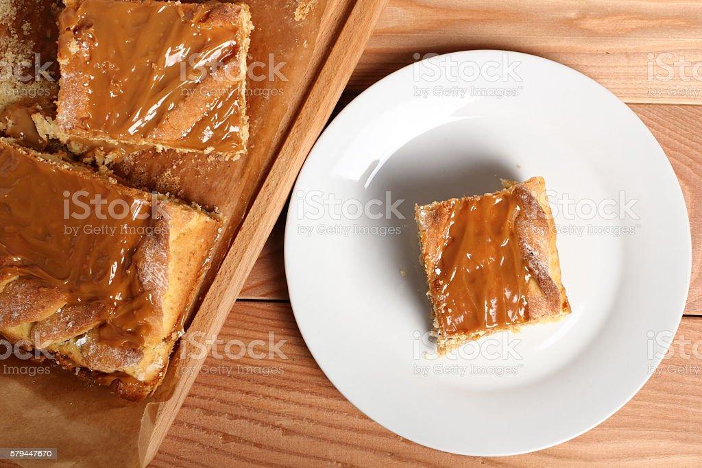 Shortcrust pastry cake covered with fudge caramel cream stock photo