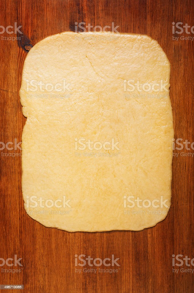 Shortcrust pastry on the wooden table stock photo