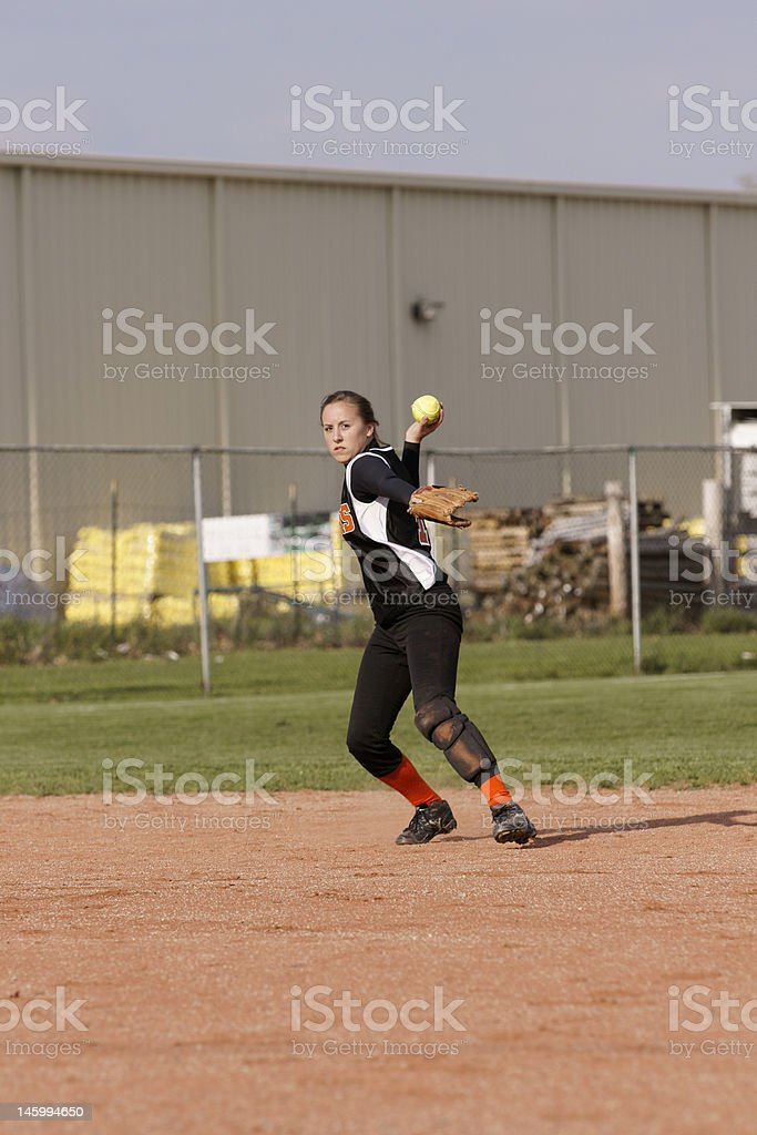Shortstop making a throw stock photo