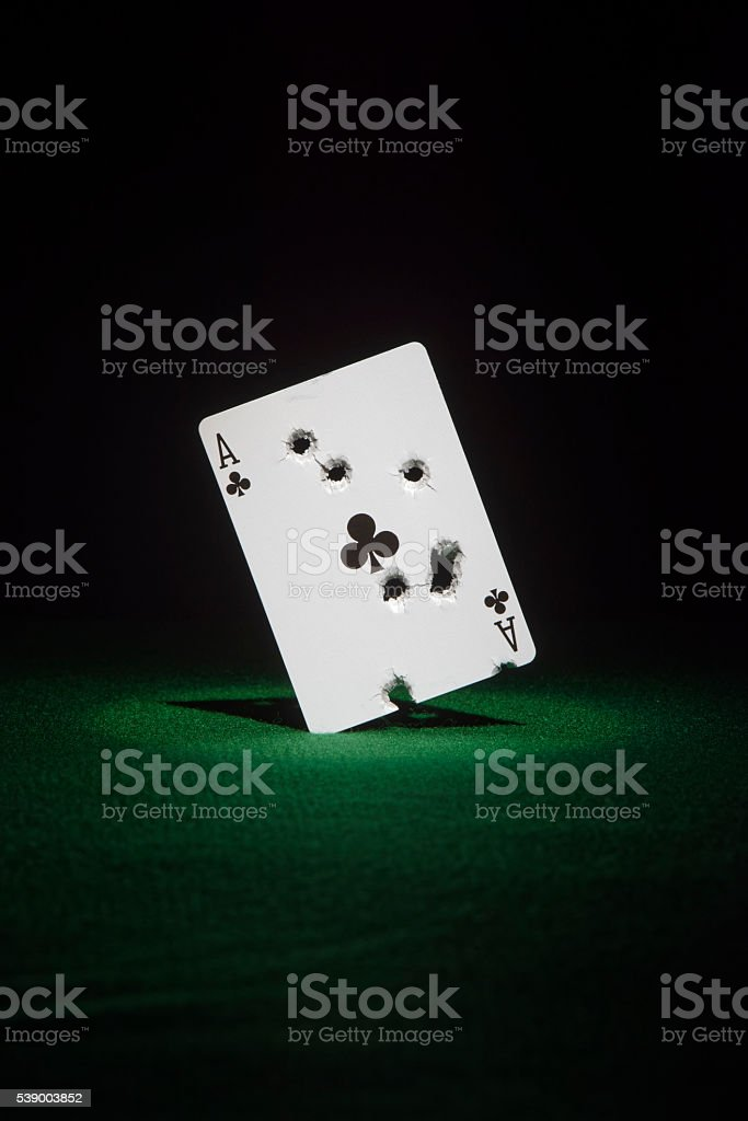 Shot Ace of Clubs stock photo