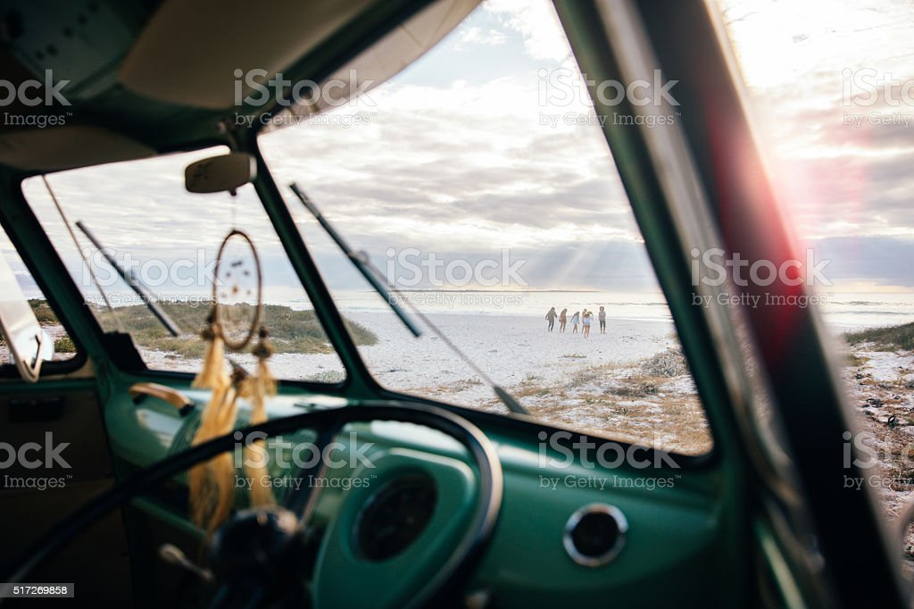 Shot from Retro Road Trip Van Window onto Sandy Beach stock photo