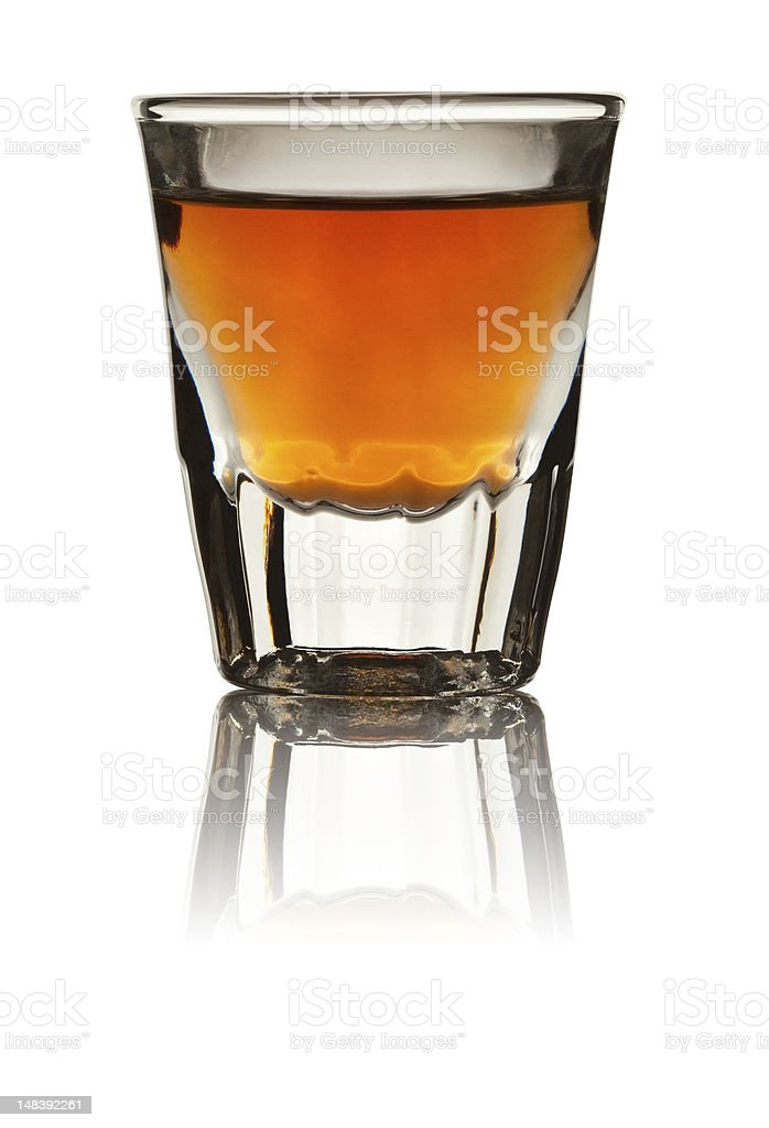 Shot Glass Filled with Whiskey Isolated on White stock photo