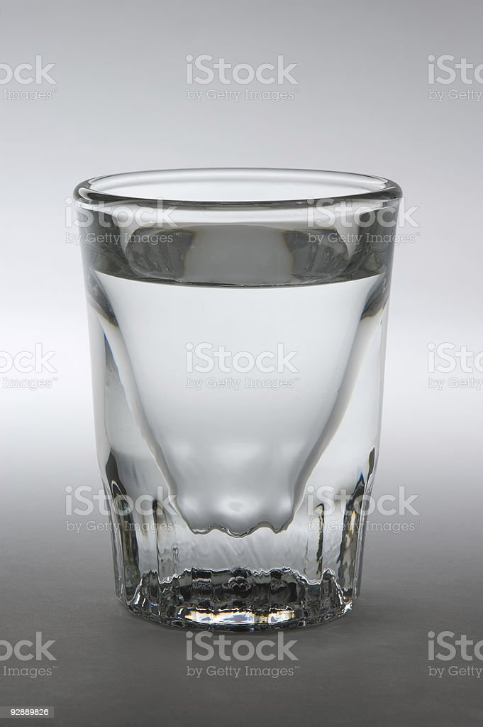 Shot Glass with Clear Liquid stock photo