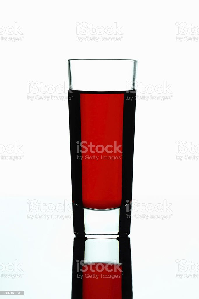 Shot glass with red drink stock photo