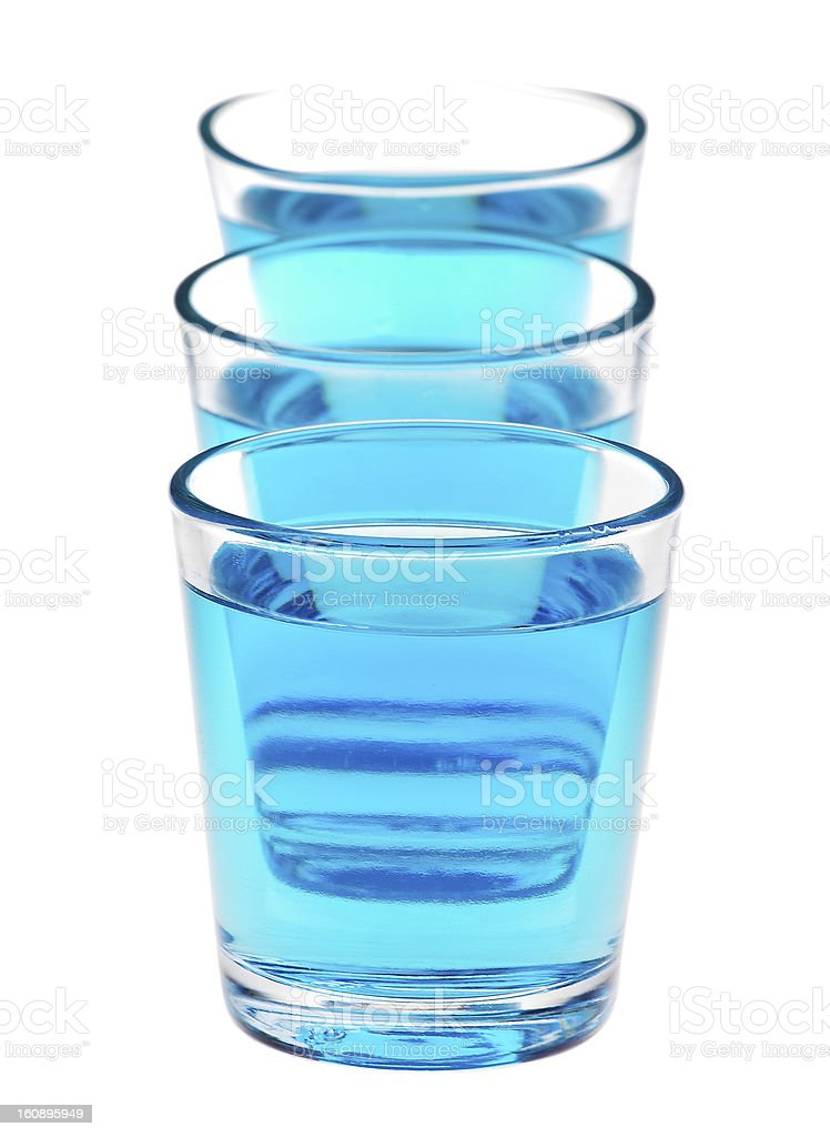 shot glasses with blue liquid royalty-free stock photo