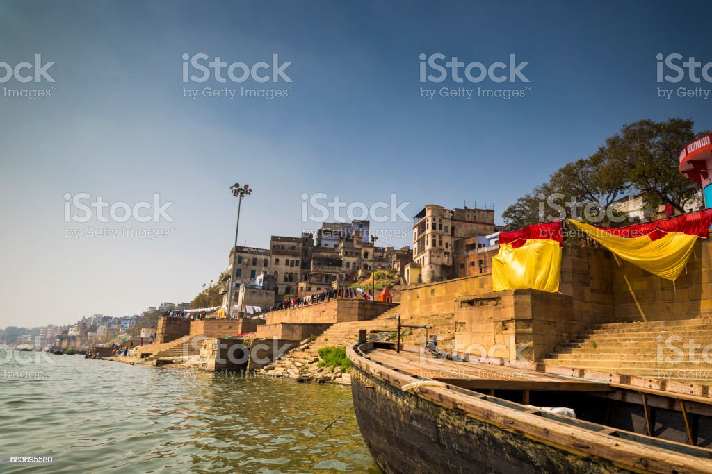Shot in the holy Indian city of Varanasi, a glimpse at one of Ganges river ghats. stock photo