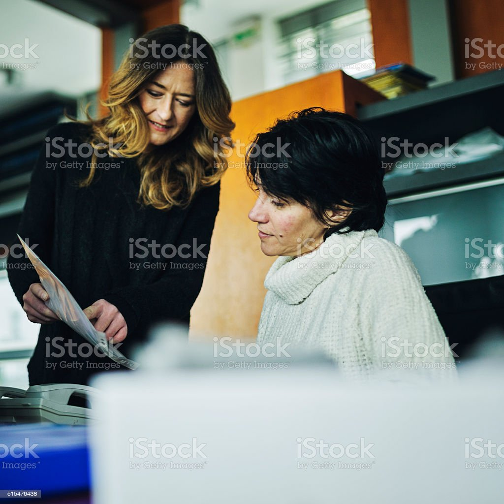 Shot of a consultant explaining a document stock photo