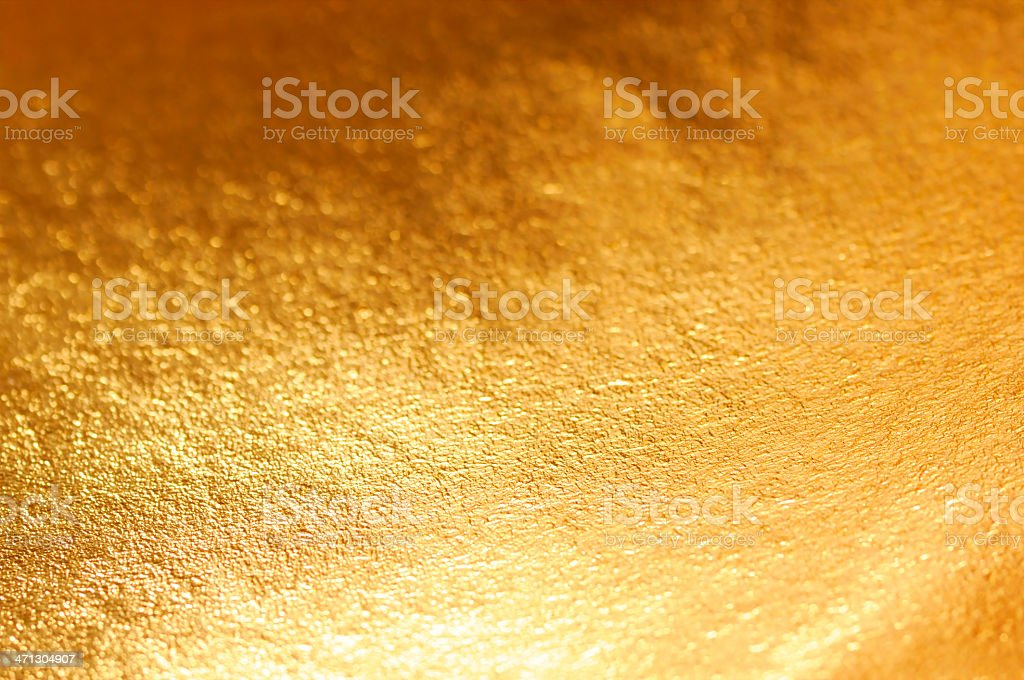 A shot of a gold metallic background royalty-free stock photo