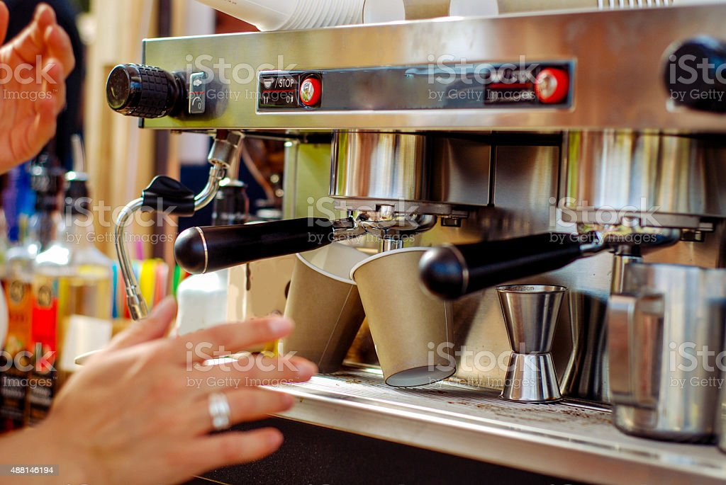 Shot of a male barista making a cup of coffee stock photo