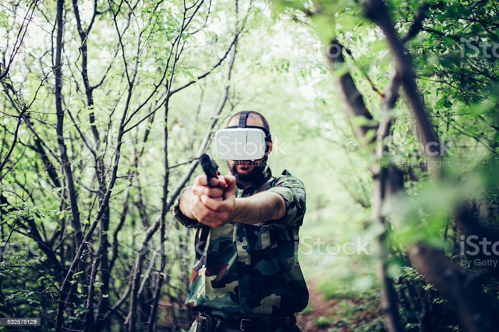 Shot of a soldier holding gun in virtual reality stock photo