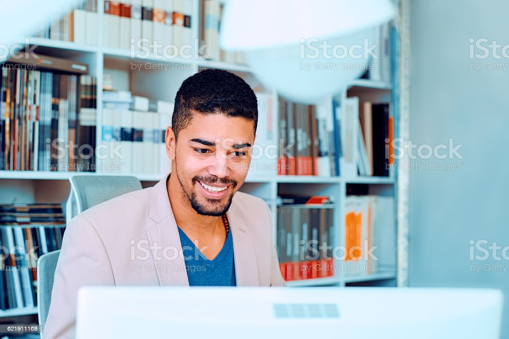 Shot of a young businessman sitting in his office stock photo