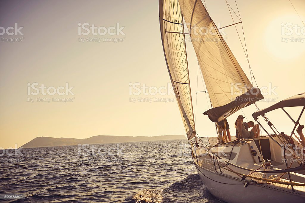 Shot of a young couple spending time together on a yacht stock photo