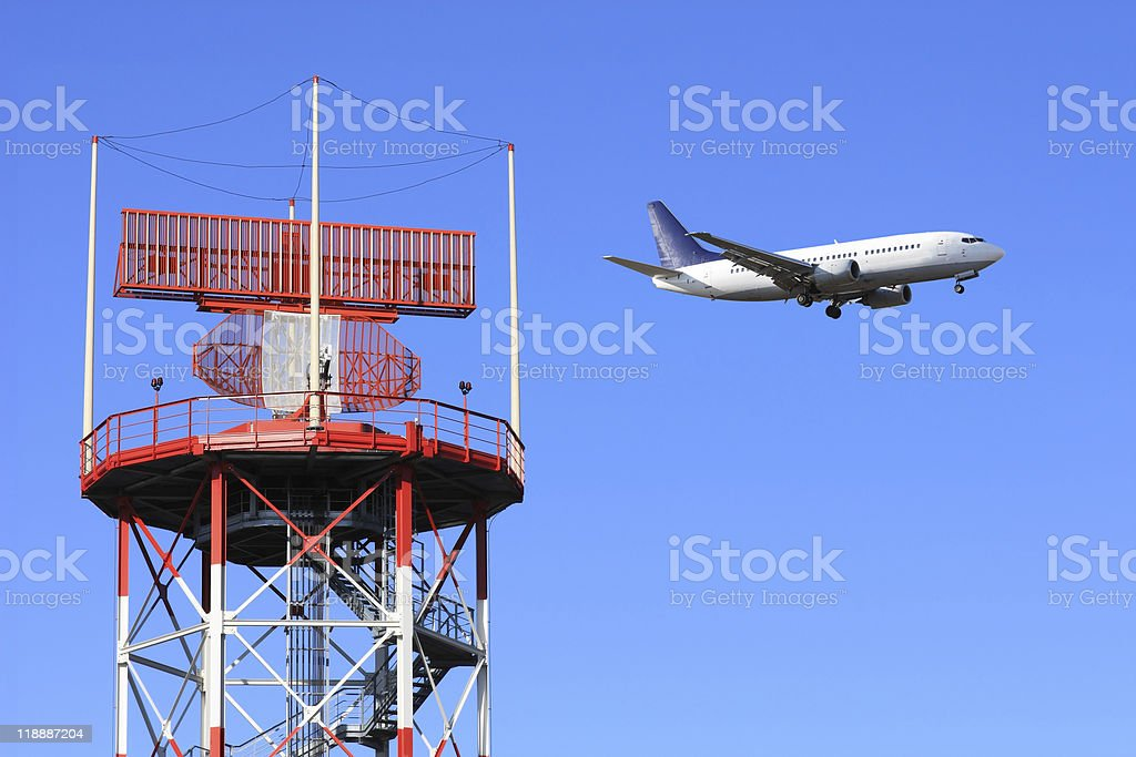 Shot of air traffic control with airplane flying by royalty-free stock photo