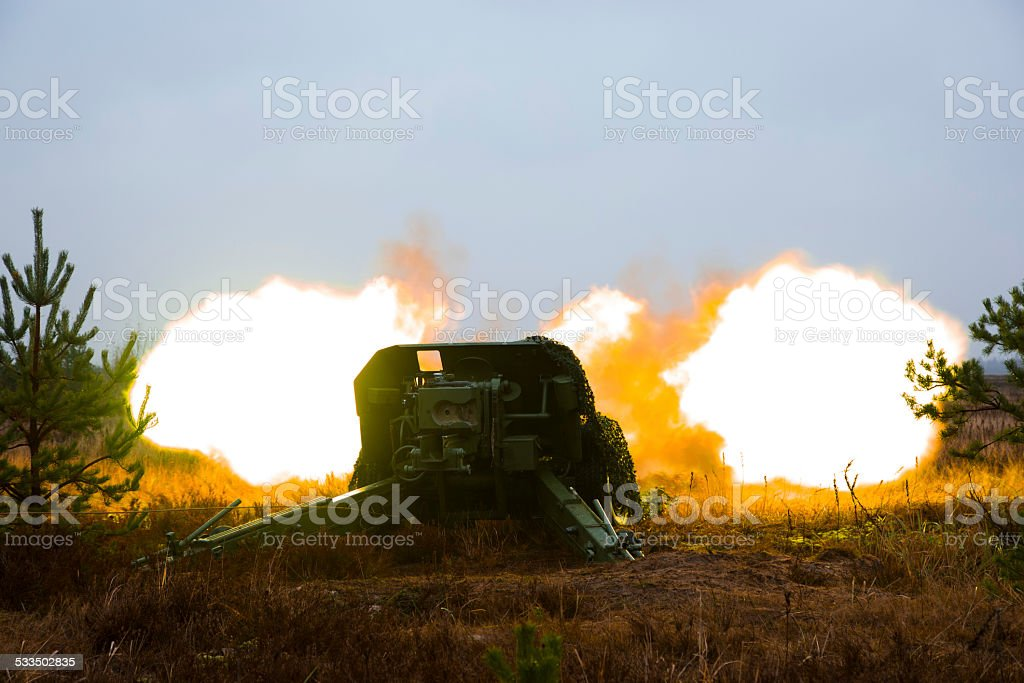 shot of artillery fire with flash stock photo