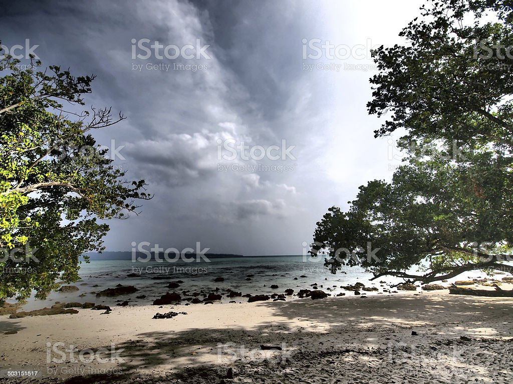 HDR shot of beach with trees on either side stock photo