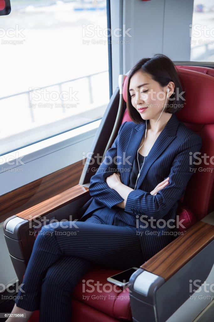 shot of beautiful business woman sitting inside high-speed...