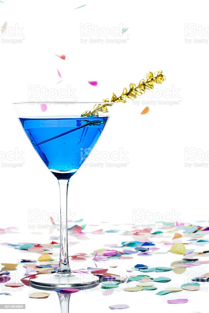 shot of blue alcohol in martini with streamer and confe stock photo