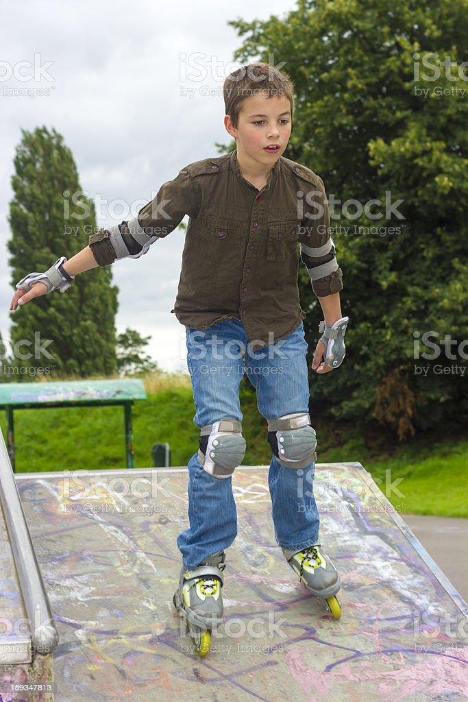 Shot of concentrated sliding rollerskaters in protection kit royalty-free stock photo
