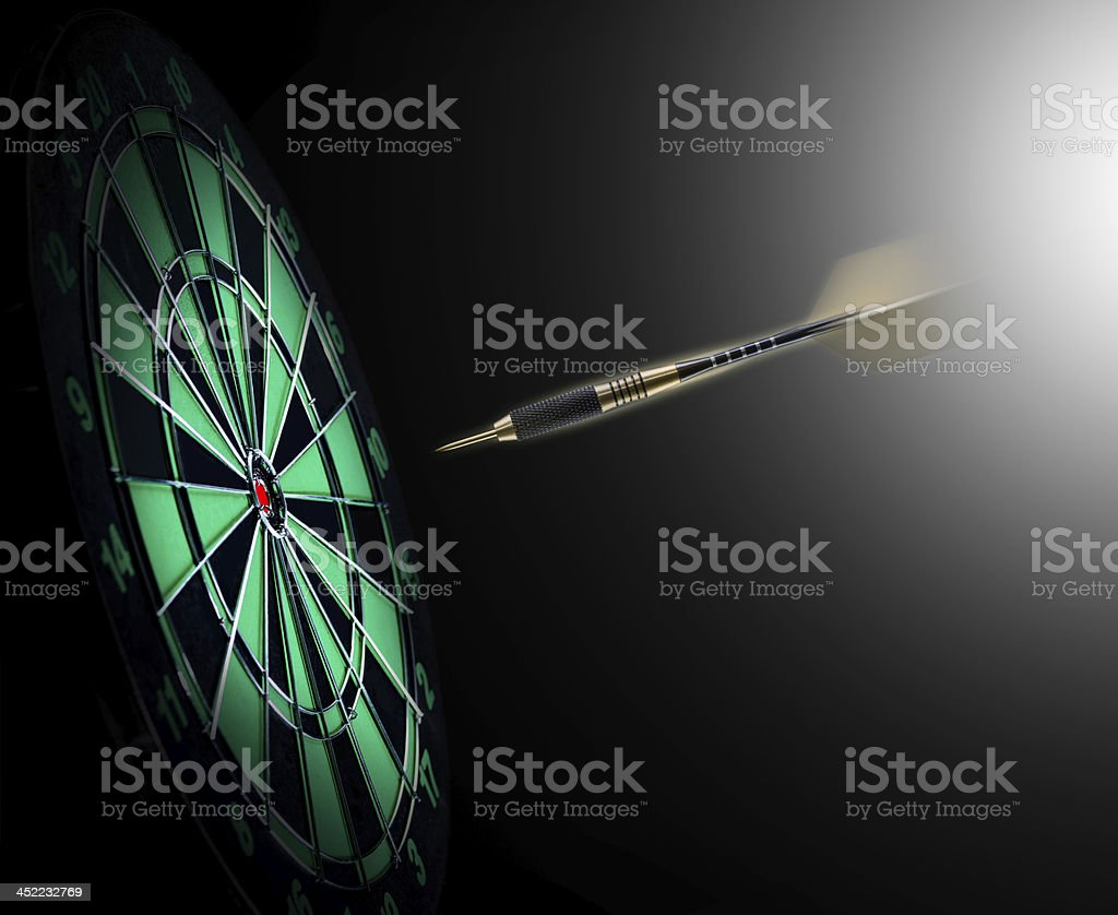 Shot of darts in bullseye on dartboard stock photo