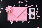 Shot of envelope and chocolates next to it
