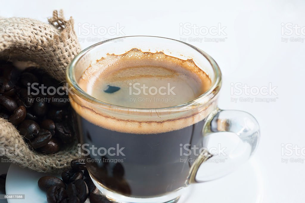 Shot of espresso with bean stock photo