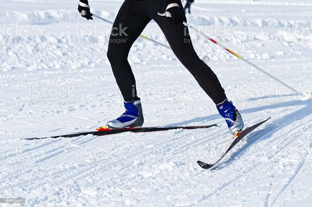 Shot of legs in black attire cross country skiing stock photo