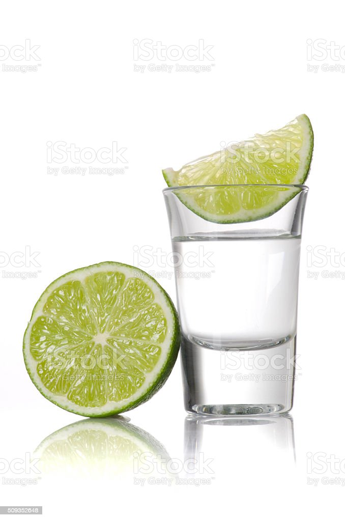 Shot of tequila with a slice of lime stock photo