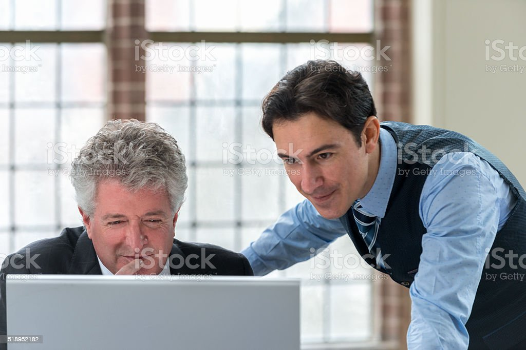 Shot of two businessman looking at monitor stock photo