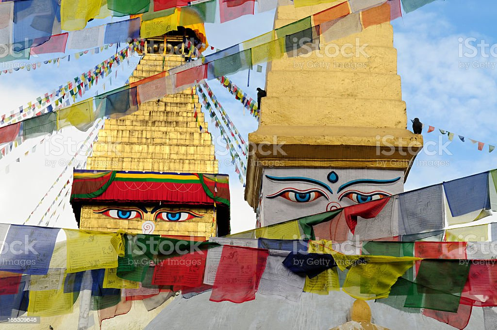 A shot of two towers of Boudhanath Stupa in the daytime royalty-free stock photo