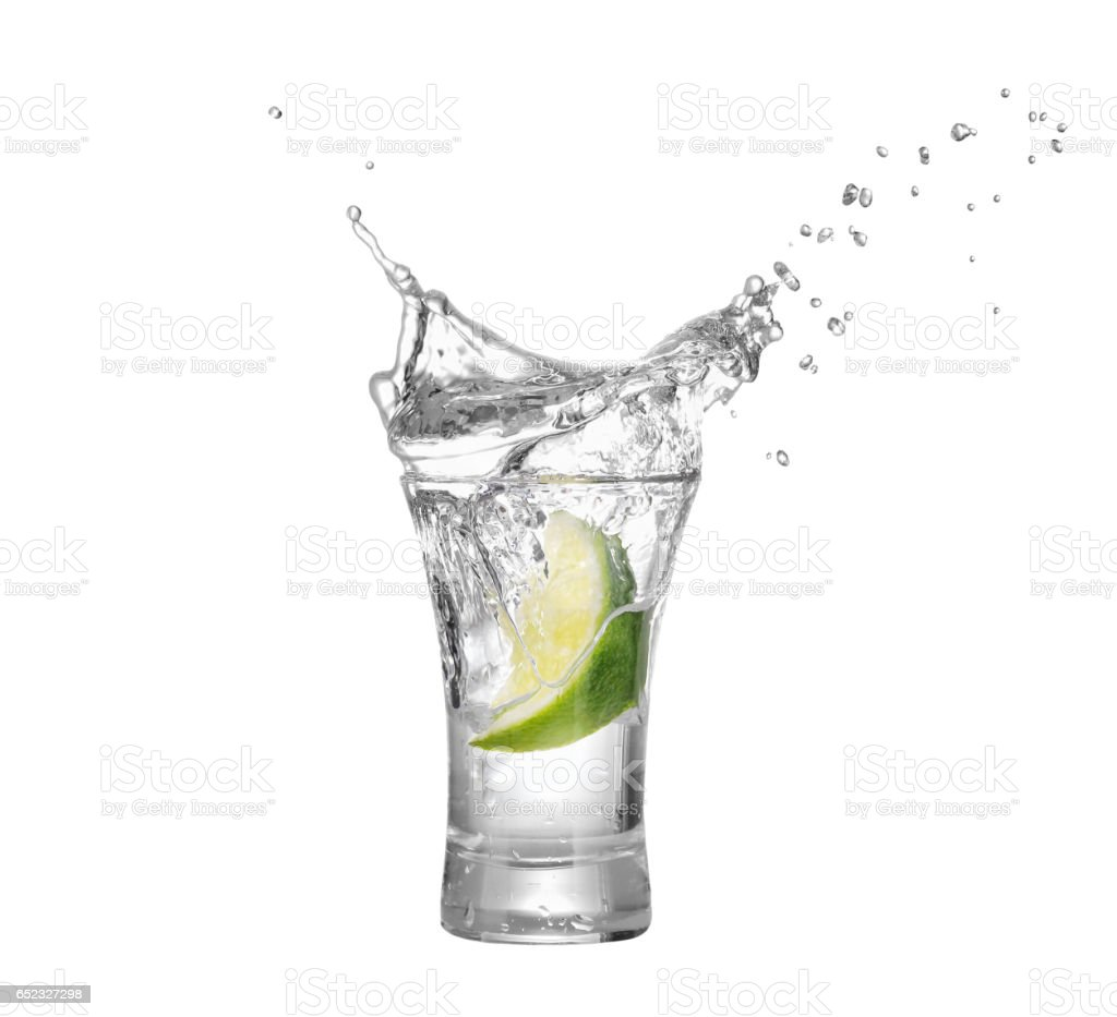 shot of vodka or tequila with lime slice stock photo