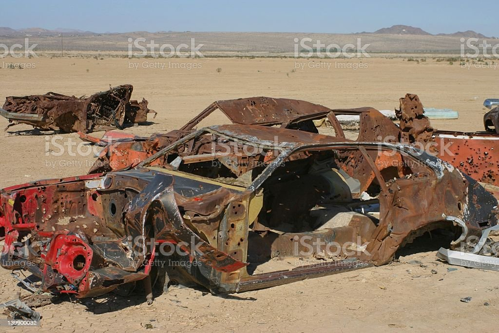 Shot up cars in the desert royalty-free stock photo