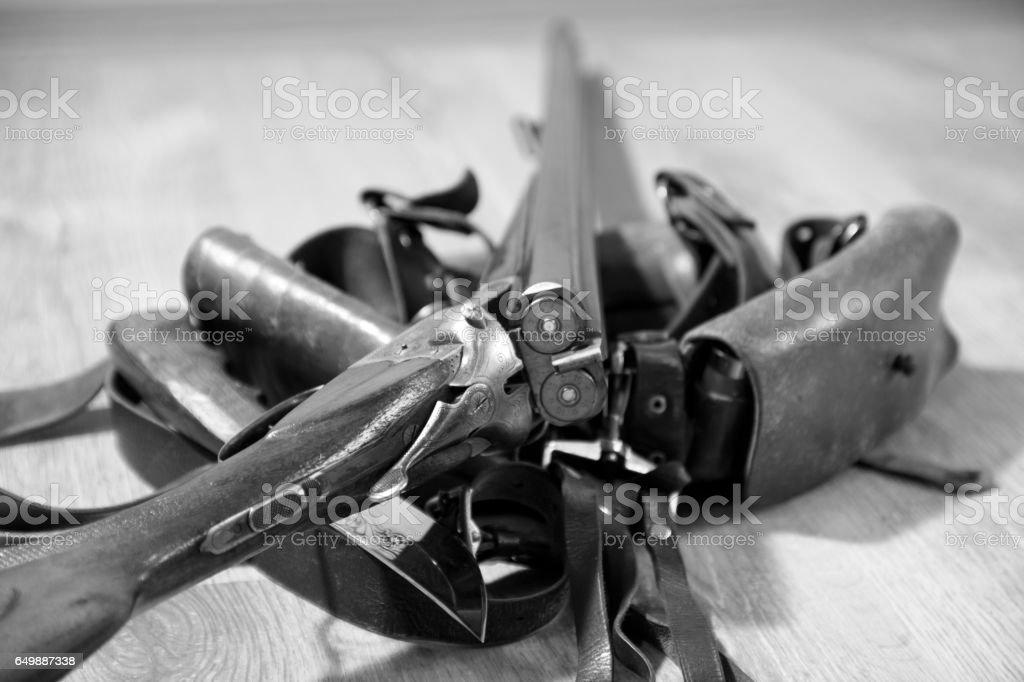 Shotgun 16 gauge and bandolier. Two bullets in barrels stock photo