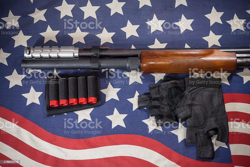 Shotgun American flag background. stock photo